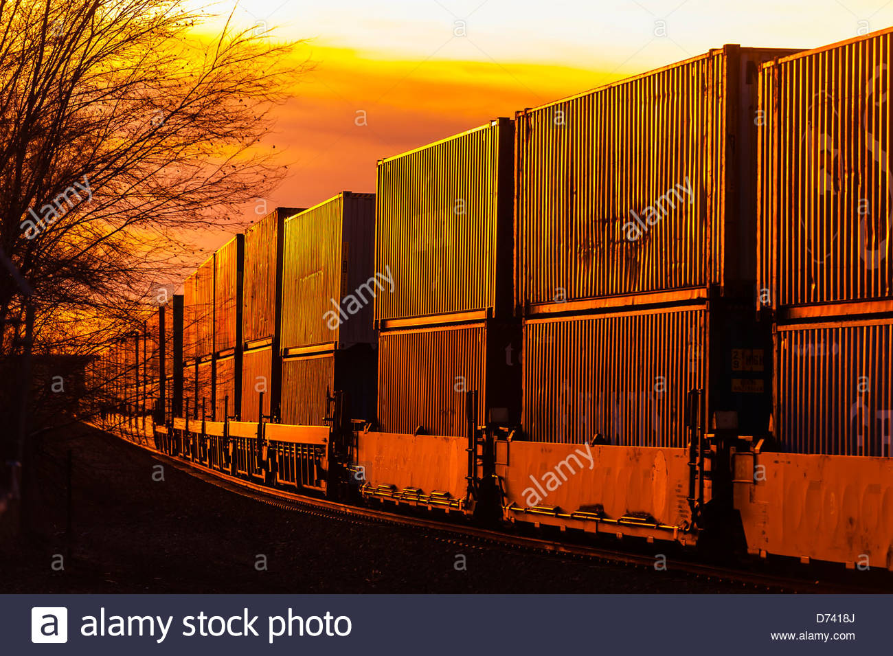 A freight train carrying contrainers, near Gallup, New Mexico USA. - Stock Image