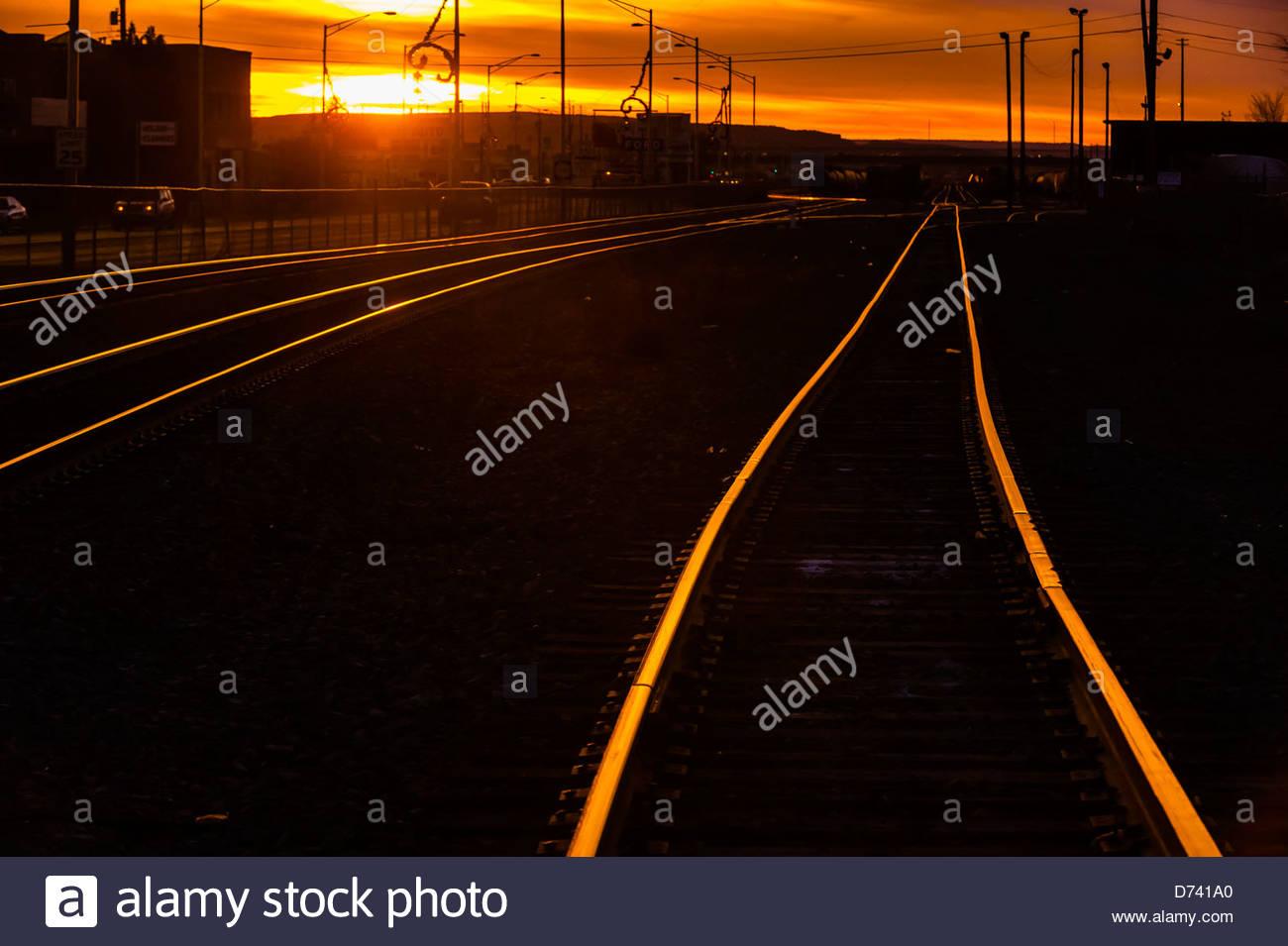 Train tracks at sunset, Gallup, New Mexico USA. Stock Photo