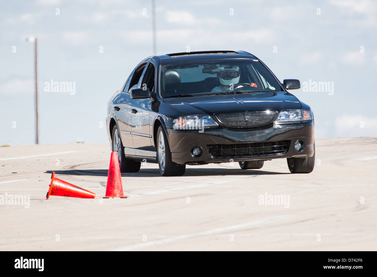 A 2003 Black Lincoln Ls In An Autocross Race At A Regional Sports