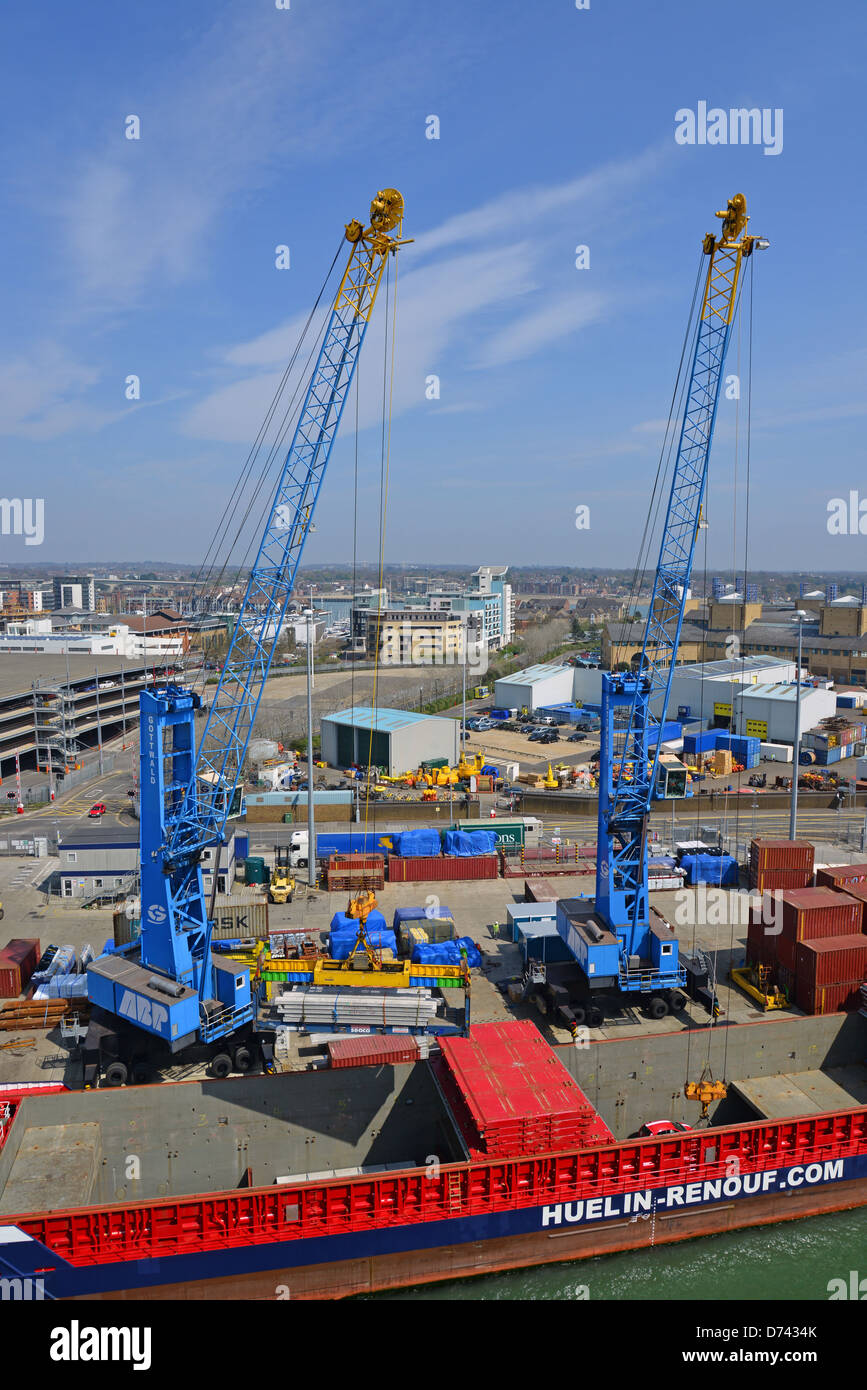 Cranes loading containers on Huelin Renouf container ship, Port of Southampton, Southampton, Hampshire, England, - Stock Image