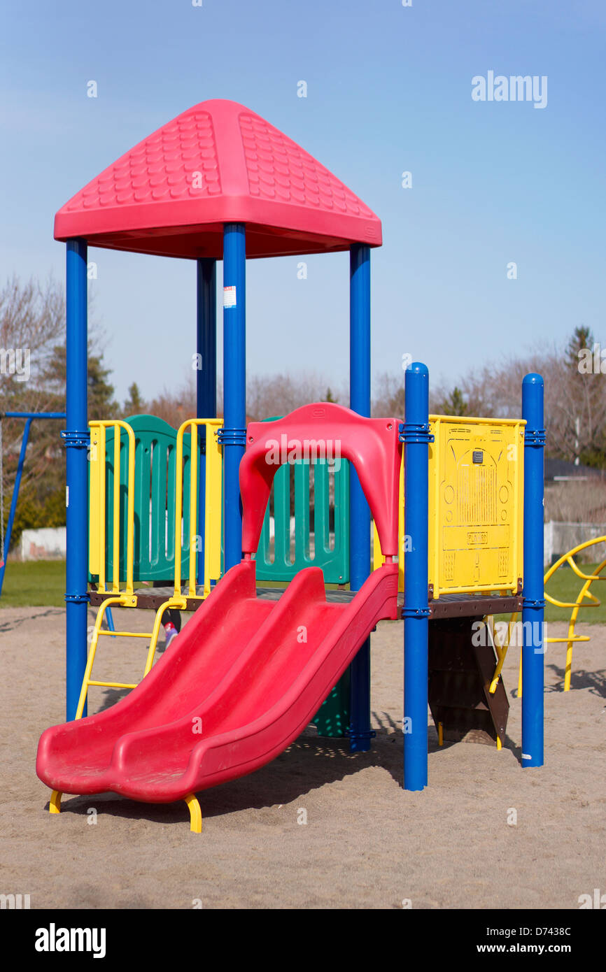 Children's Playground Slides, Outdoors School Grounds - Stock Image