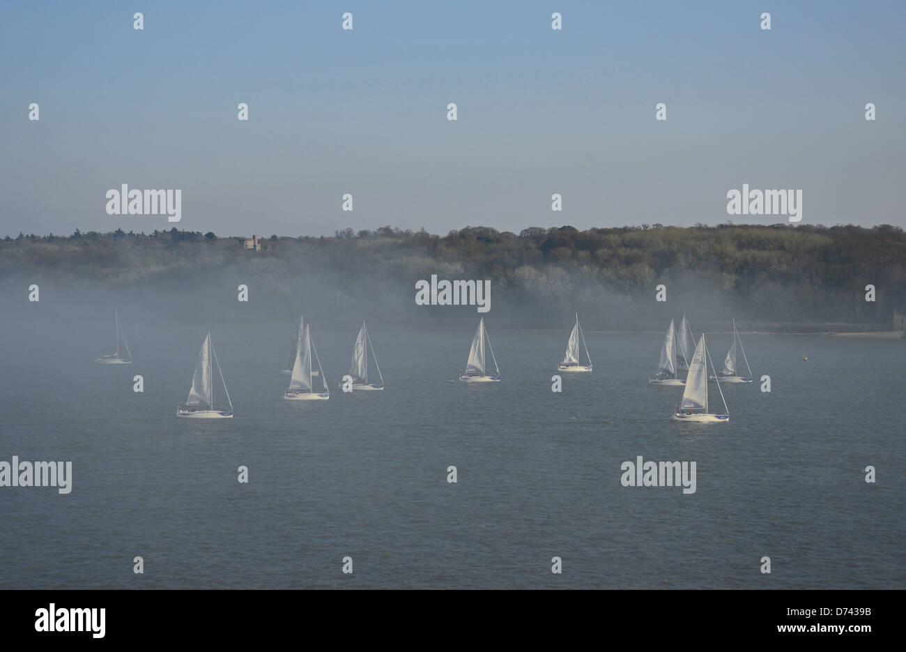 Yacht race in harbour mist, Port of Southampton, Southampton, Hampshire, England, United Kingdom - Stock Image
