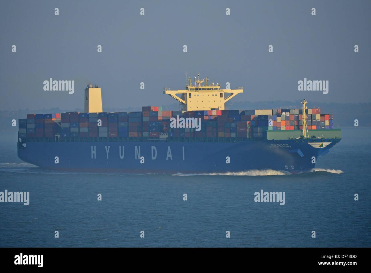 Hyundai Tenacity container ship entering Port of Southampton, Southampton, Hampshire, England, United Kingdom - Stock Image