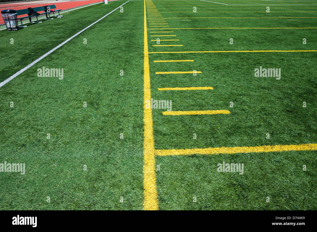 Sideline on American Football artificial turf field with hash marks. - Stock Image