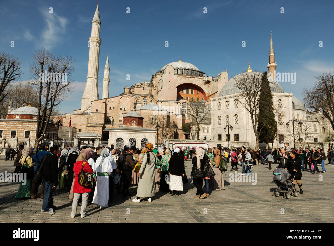 Tourists outside of the Istanbul landmark Hagia Sofia, Turkey. - Stock Image