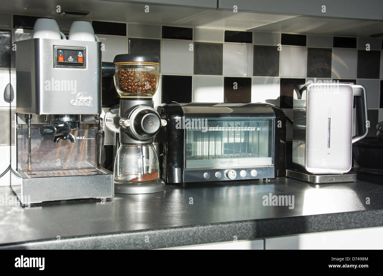 Modern Kitchen Appliances (coffee Machine, Bean Grinder, Toaster, Kettle)  In A Contemporary Kitchen. UK, 2013