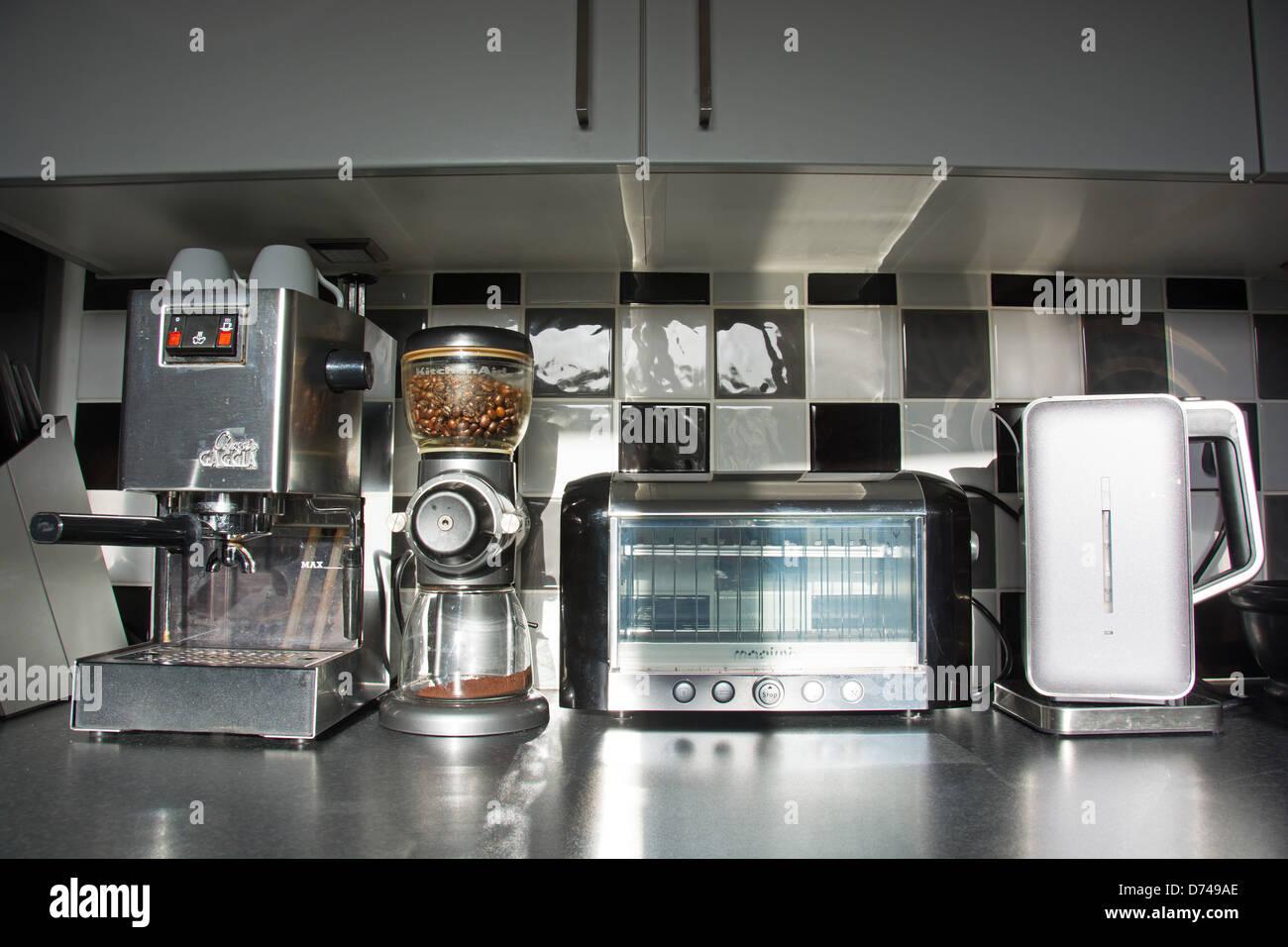 modern kitchen appliances coffee machine bean grinder toaster kettle in a contemporary kitchen uk 2013