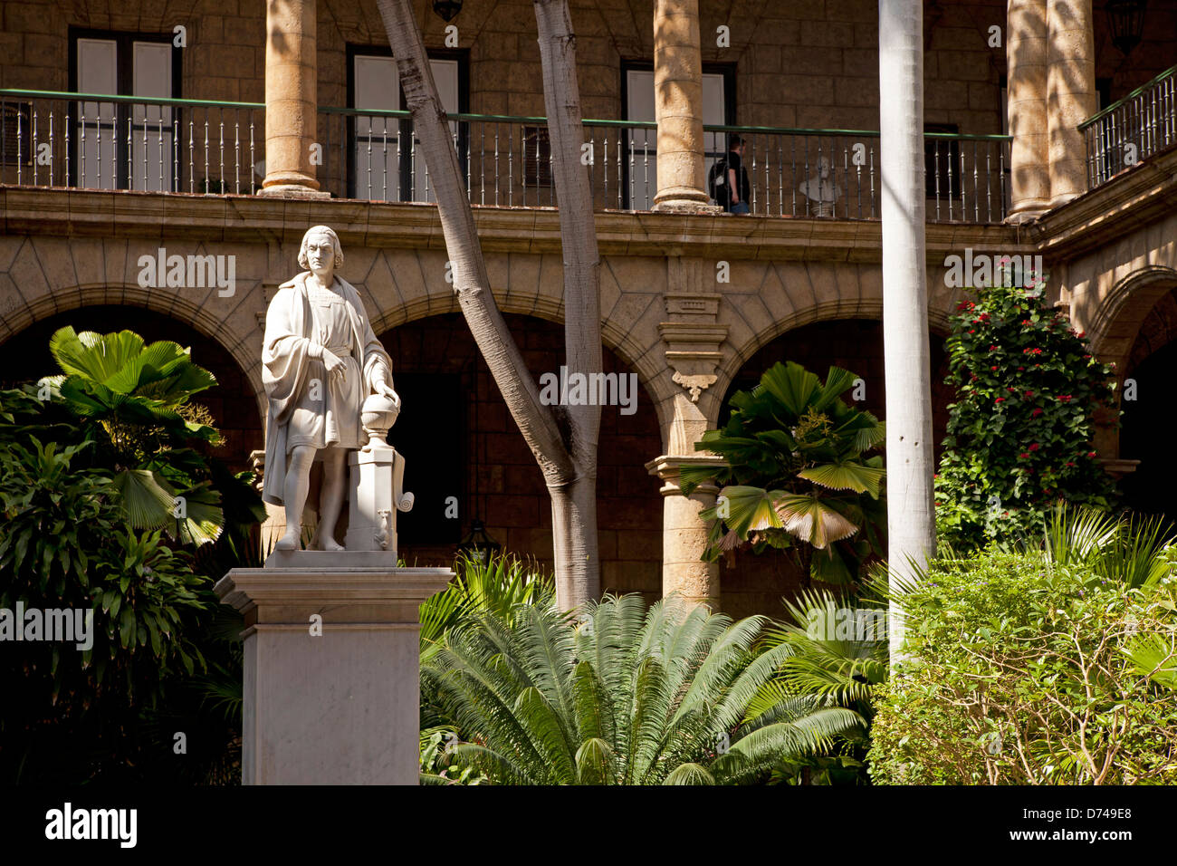 marble statue of Christopher Columbus in the courtyard of the city museum Palacio de los Capitanes Generales in Stock Photo