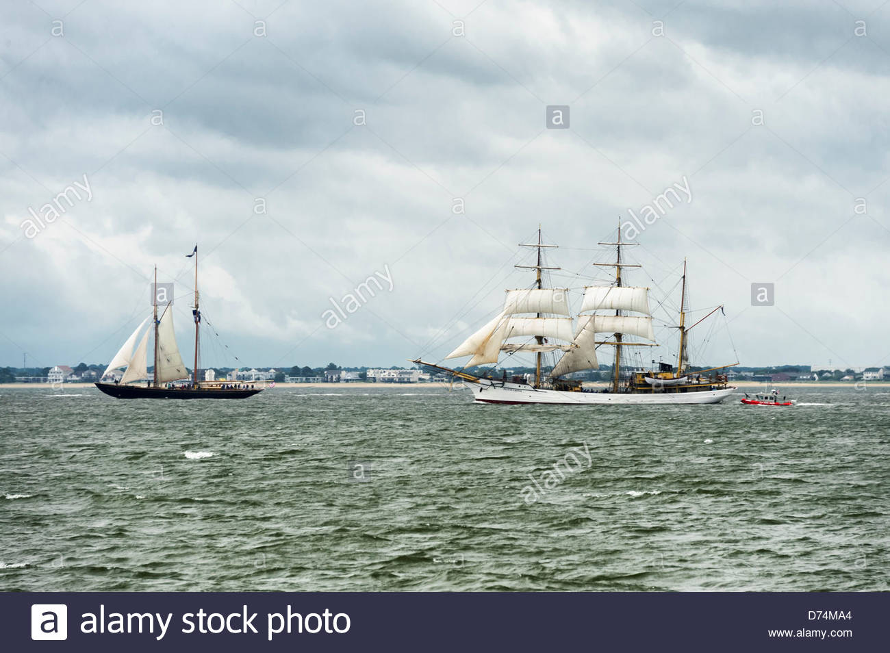 Schooner Virginia United States followed by Picton Castle form Cook Islands leaving Hampton Roads Harbor conclusion - Stock Image