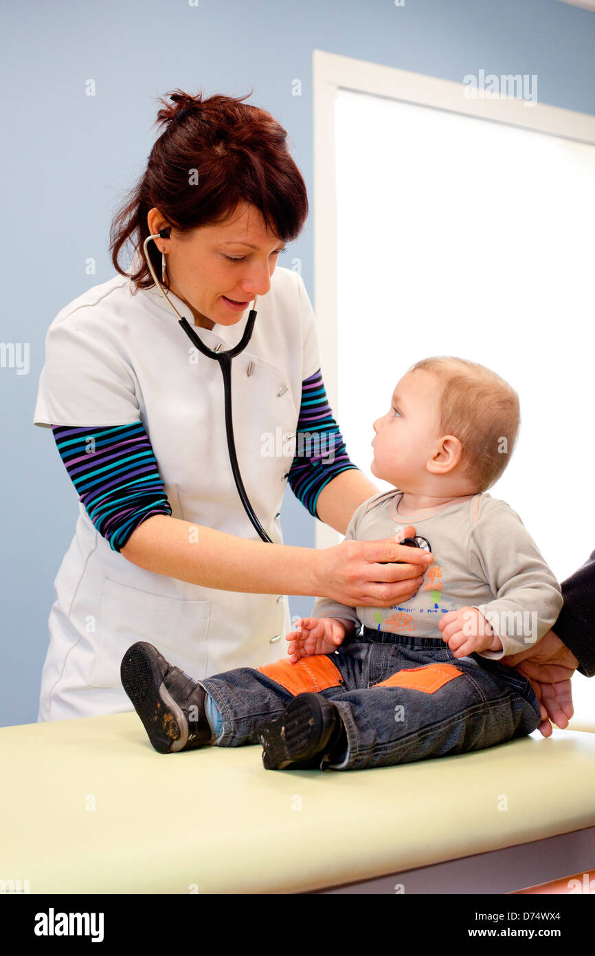 Physical Therapist performing respiratory physiotherapy on baby. - Stock Image