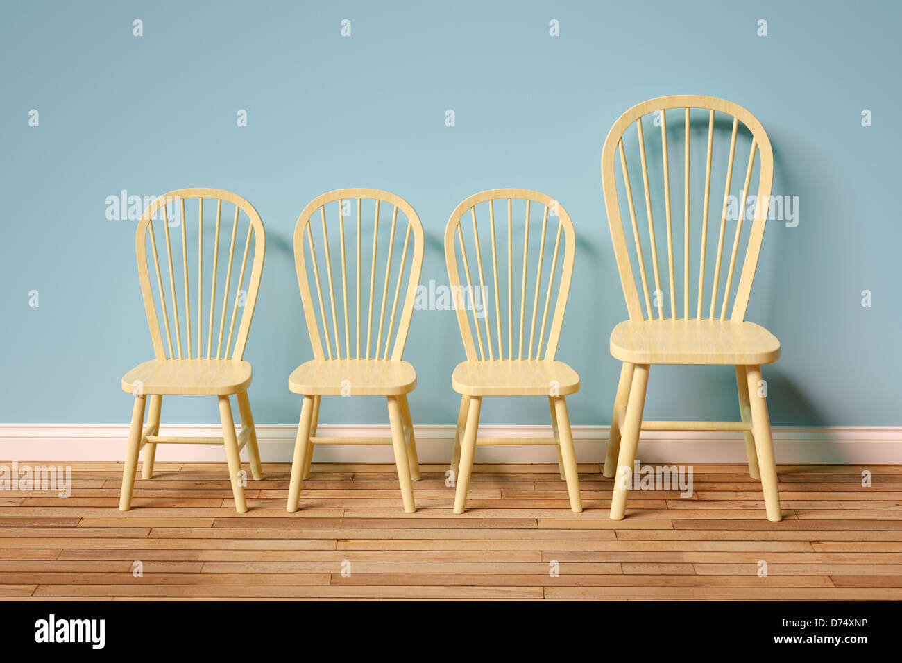 Row of empty chairs - three small, one large - Stock Image