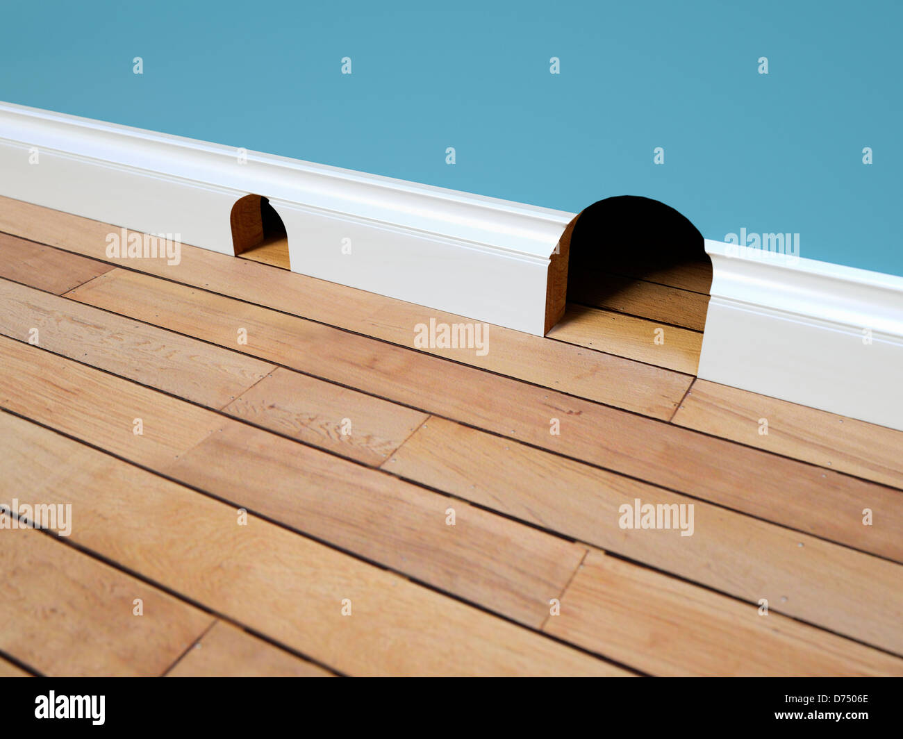 Two mouse holes - property real estate concept / trading up / up sizing / down sizing concept - Stock Image