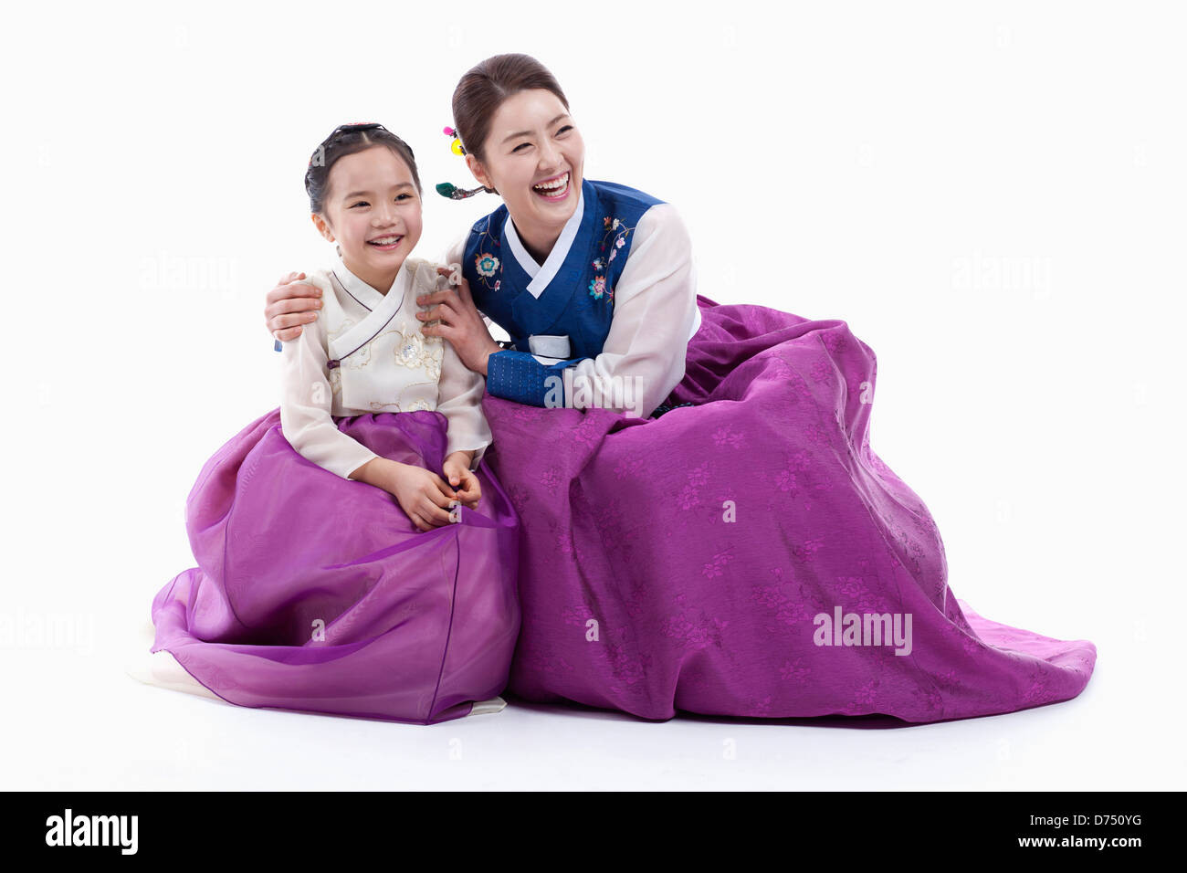 9c81ab30a mother and daughter in Korean traditional costume sitting on the floor