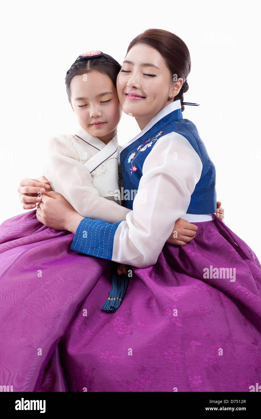 06db97ff7 mother and daughter in Korean traditional costume hugging together ...