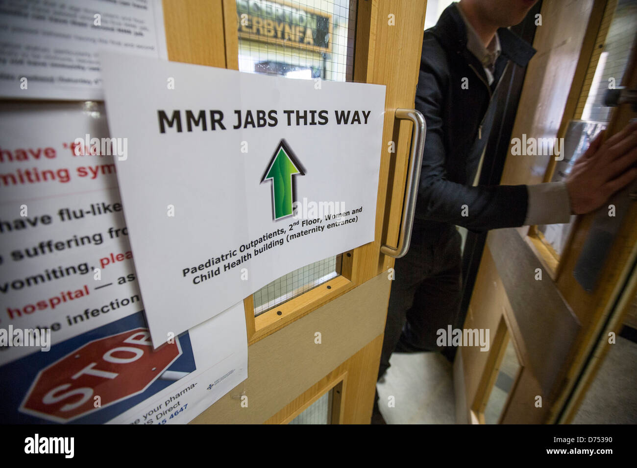 Signs pointing the way to MMR inoculation Jabs at Singleton Hospital, Swansea. - Stock Image