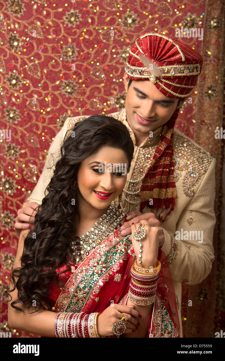 Indian newlywed couple in traditional wedding dress Stock Photo ...