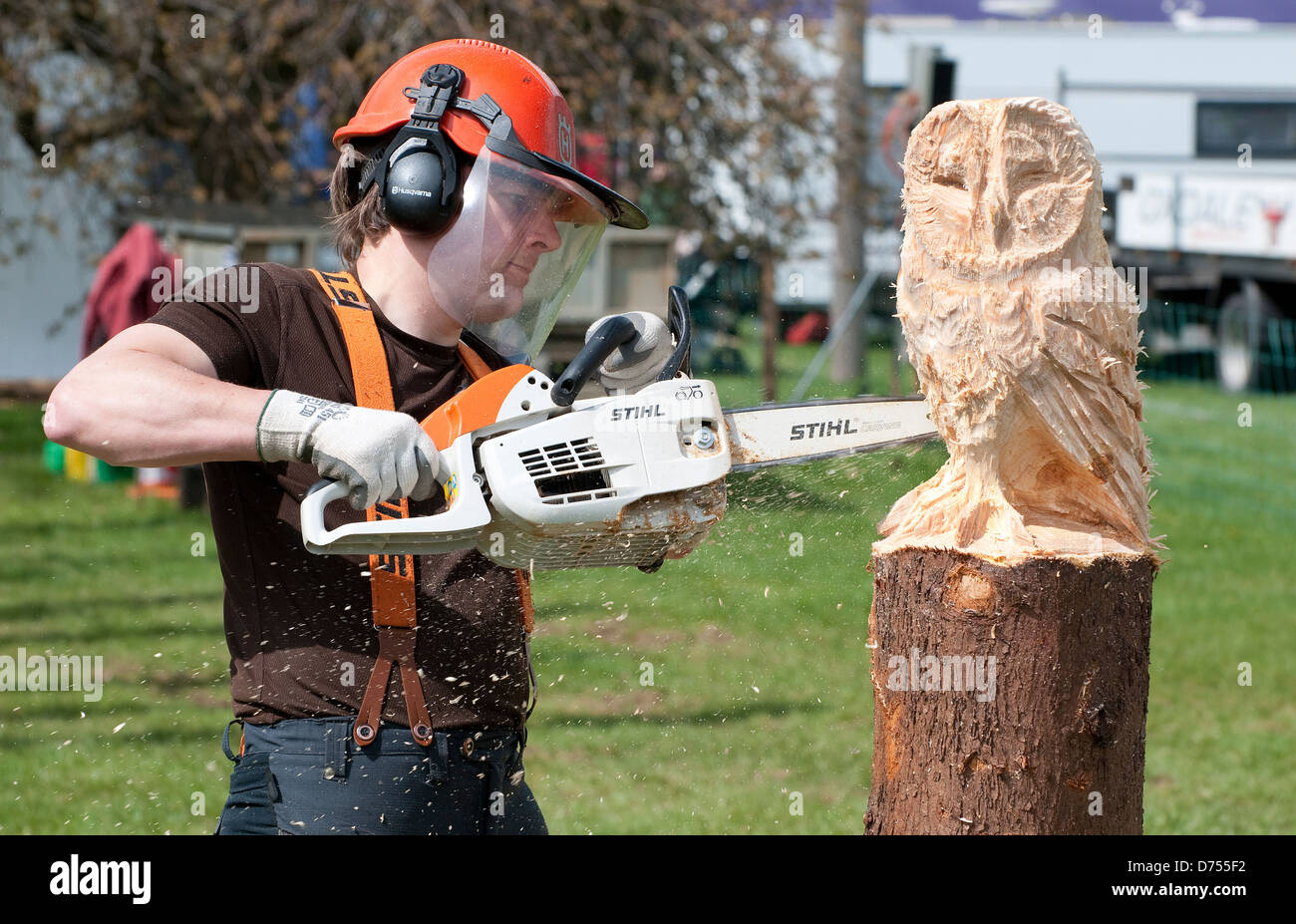 chain saw sculpture of wooden barn owl Stock Photo