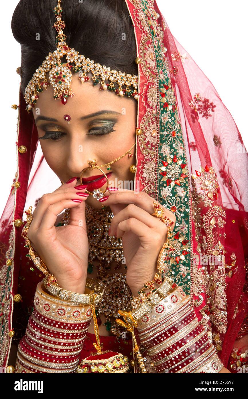 Indian Bride In Traditional Wedding Dress Adjusting Her Nose Ring