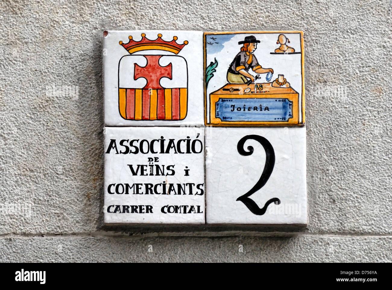 Spain, Catalonia, Barcelona. Painted ceramic tiles street sign - house number 2 Carrer Comtal. Jeweller - Stock Image