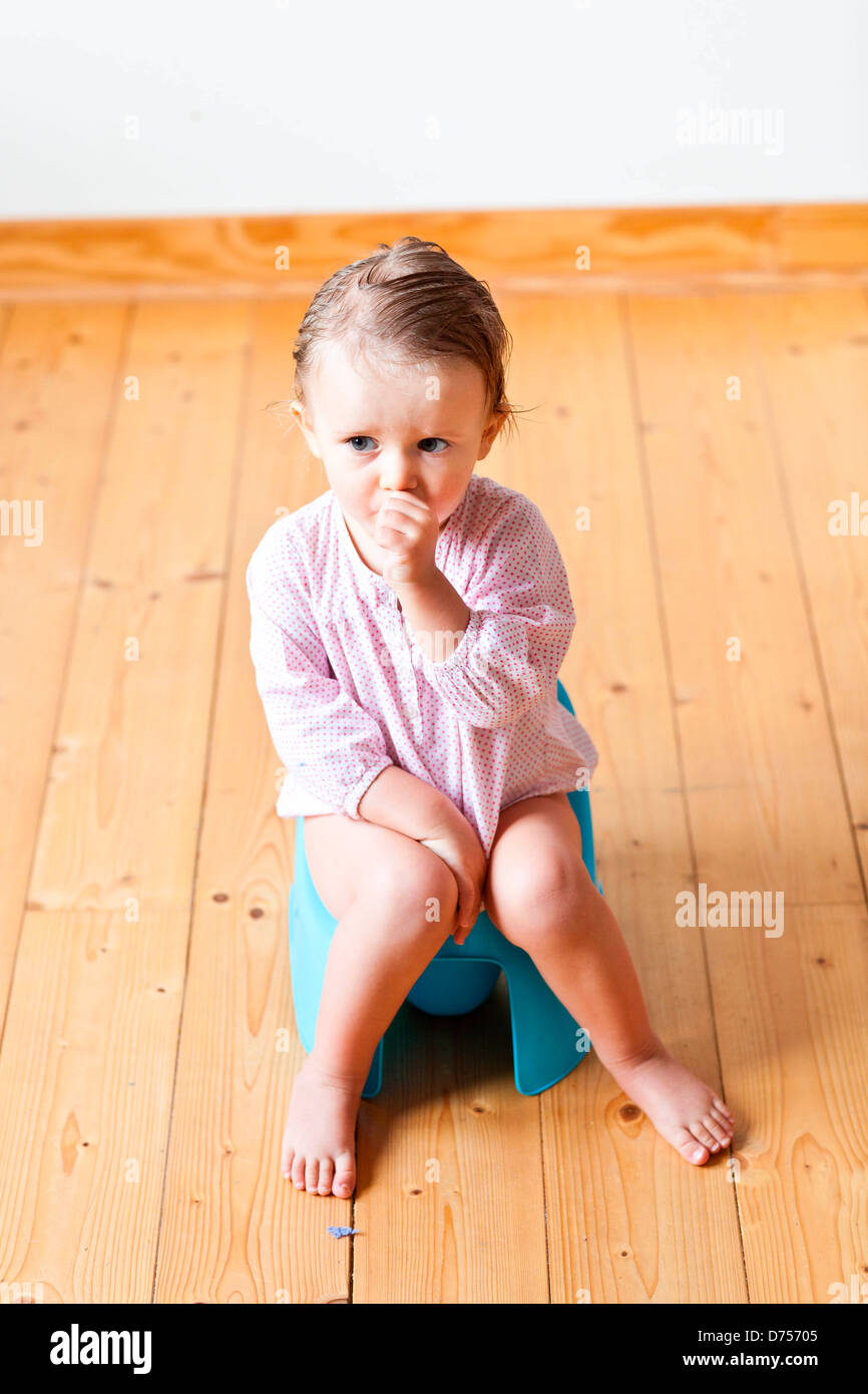 18 month old baby girl on chamberpot Stock Photo: 56048949 ...