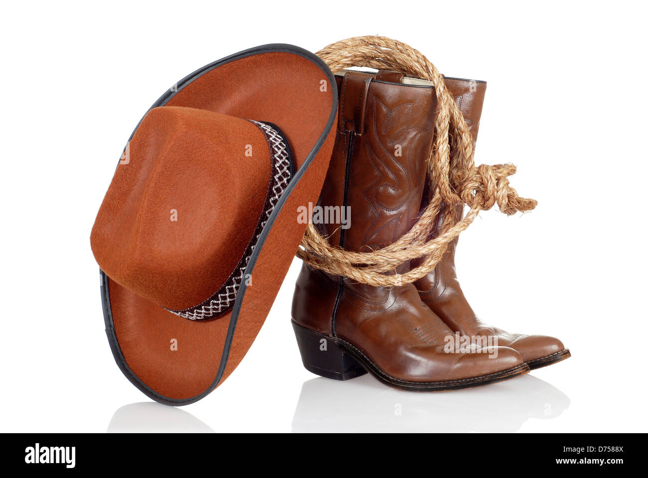 cowboy hat with a lasso and boots Stock Photo  56049978 - Alamy 19b228e4a32