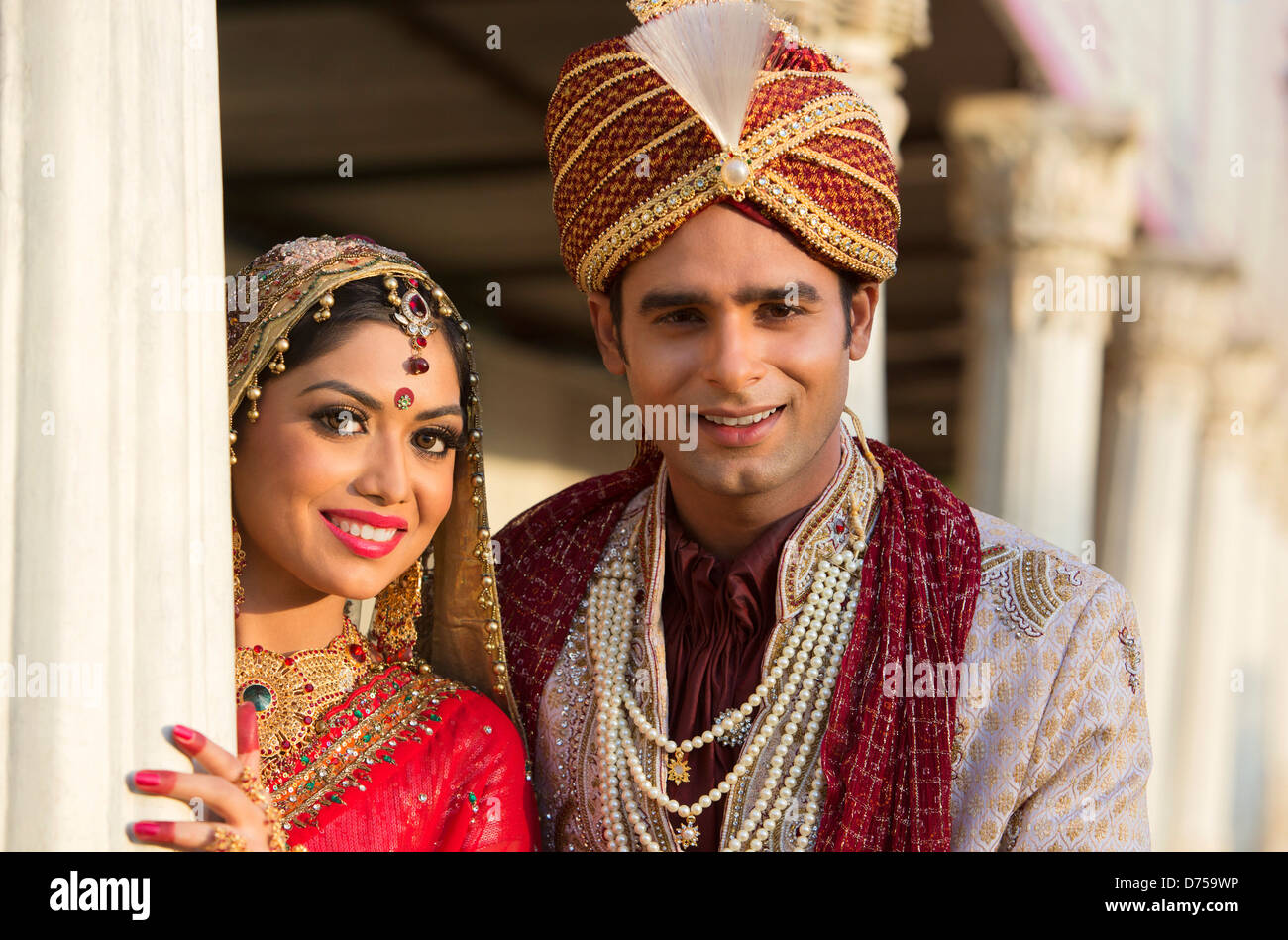 Indian bride and groom in traditional wedding dress Stock Photo ...