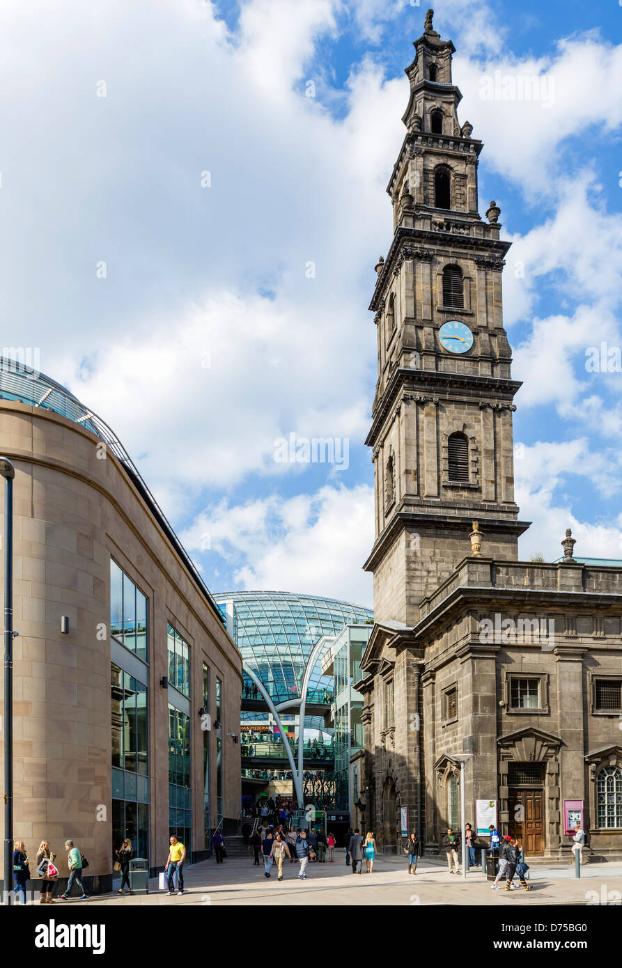 Boar Lane entrance to new (2013) Trinity Leeds shopping centre with Holy Trinity Church to right, Leeds, West Yorkshire, - Stock Image