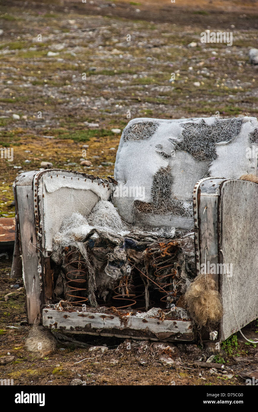 Old, ruined armchair at Camp Mansfield, the abandoned marble quarry, Blomstrandhalvoya, Svalbard Archipelago, Norway - Stock Image