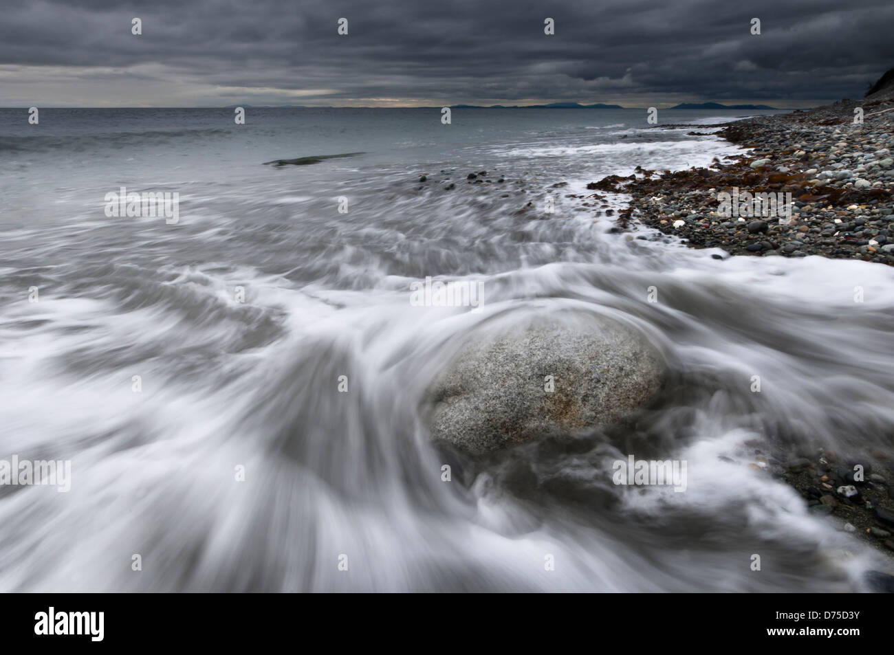 Waves wash up on the beach at Fort Ebey State Park, Whidbey Island, Washington, USA - Stock Image