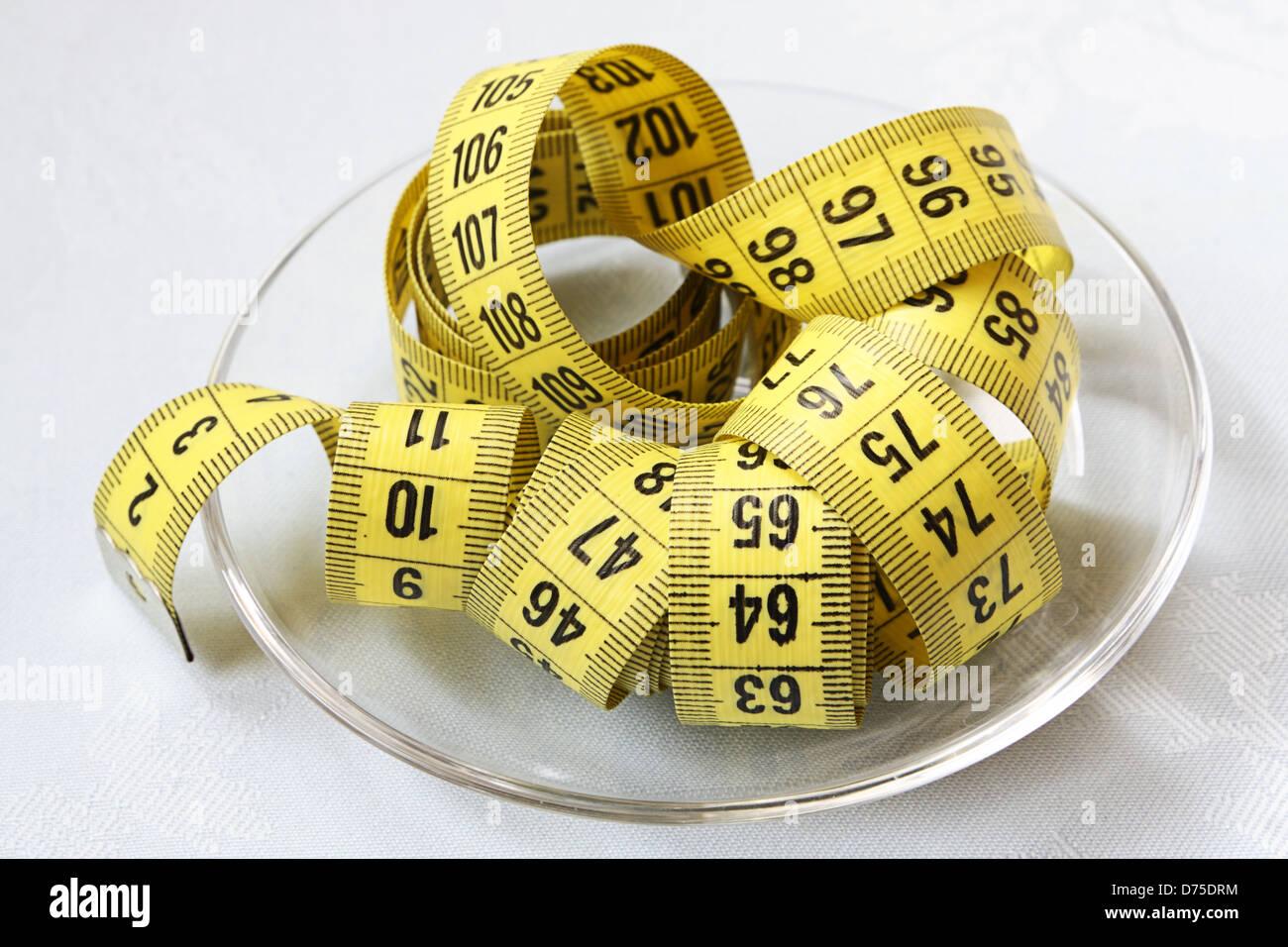Yellow tapeline on glass bowl closeup Stock Photo