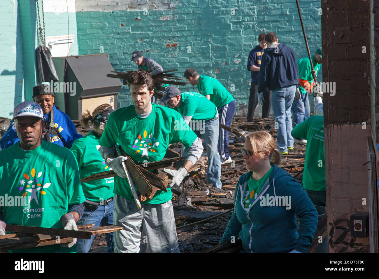 Volunteers Help Renovate Building for Community Organization - Stock Image