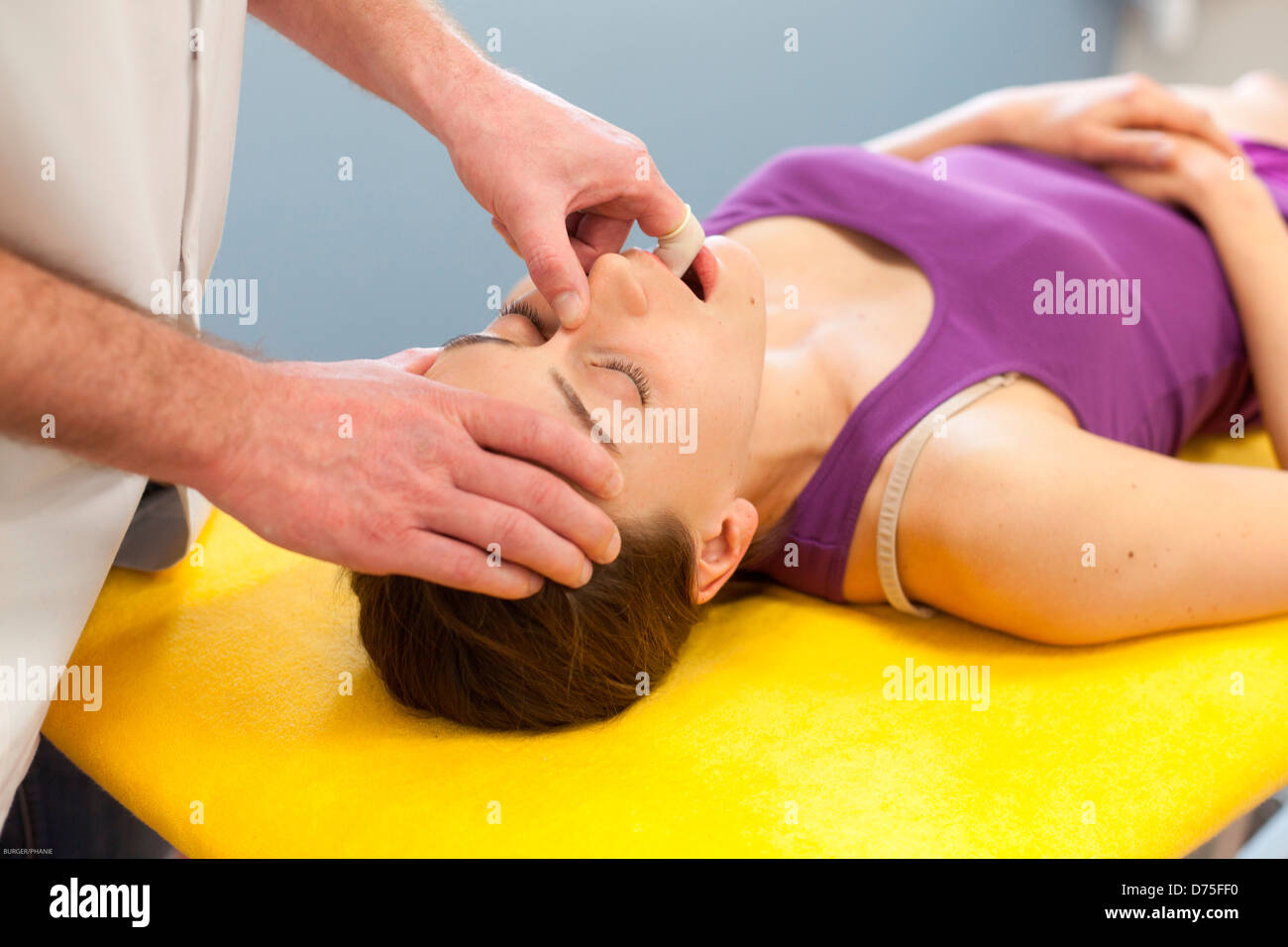 Session of cranial osteopathy, treatment with intra-oral. - Stock Image