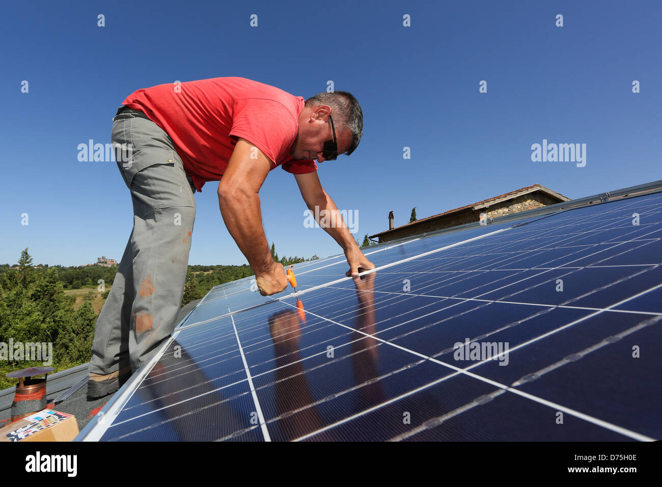 Torre Alfina, Italy, installing a solar power system on the roof of a detached house - Stock Image