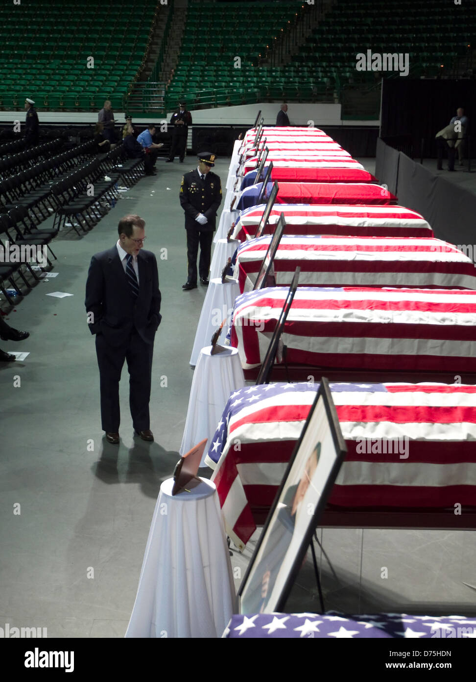 Family, co-workers and citizens mourn firefighters who died battling fire after explosion at fertilizer plant in - Stock Image