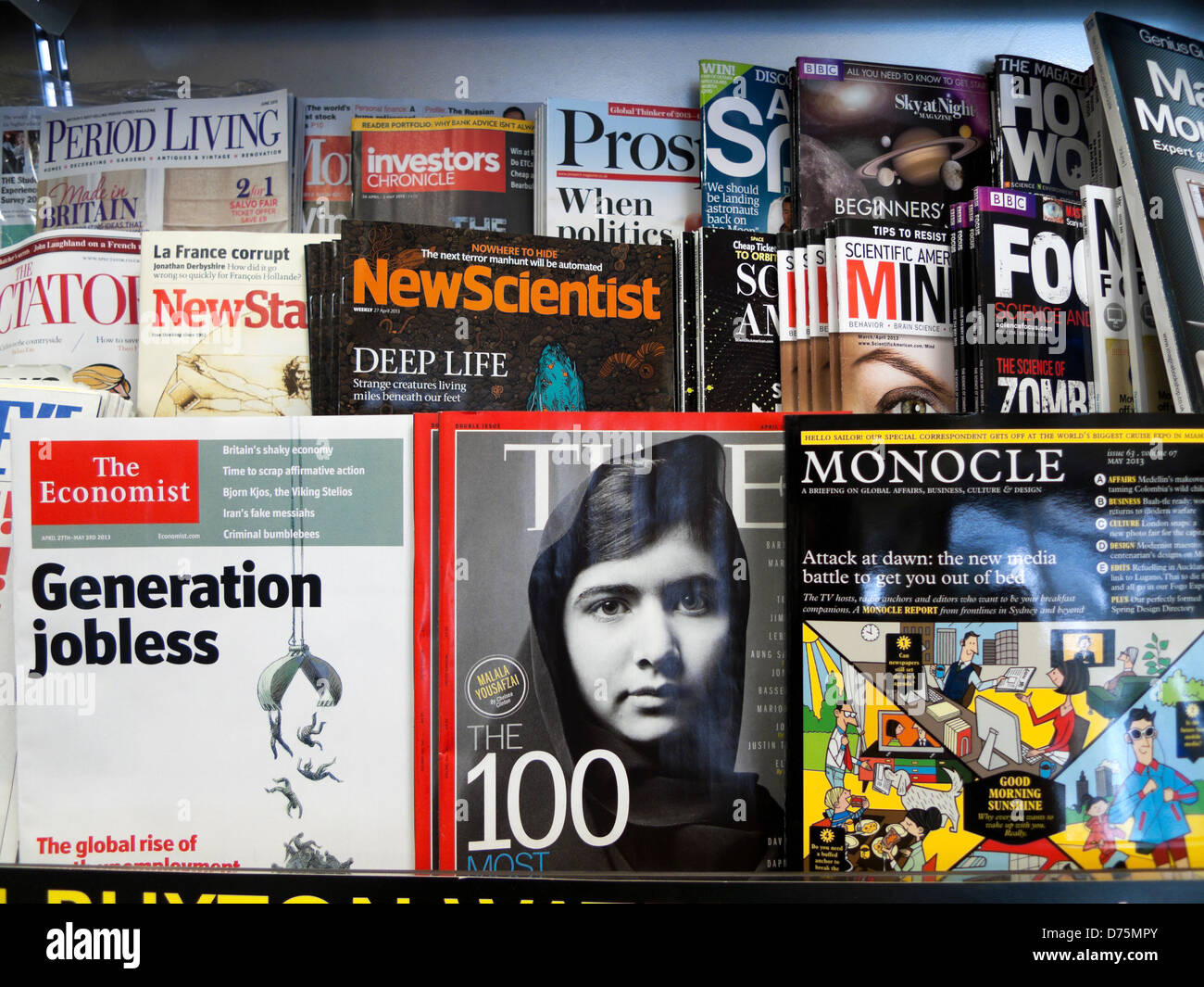 Malala Yousafzai on the cover of Time magazine on shelves next to The Economist, New Scientist & Monocle at - Stock Image
