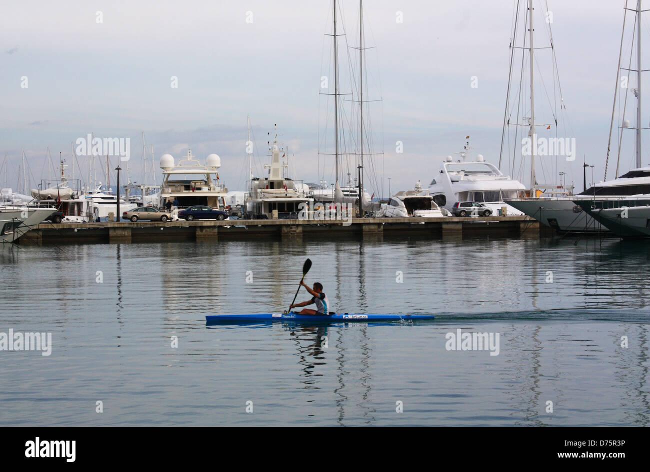 Man rowing in Palma De Mallorca, Spain Stock Photo