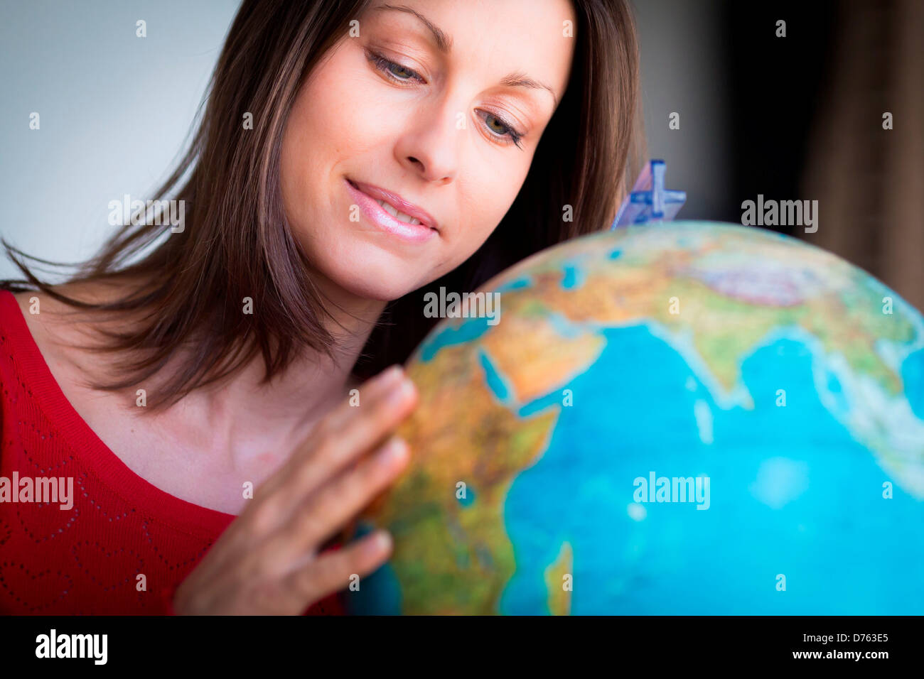 Woman looking at a map of the world Stock Photo