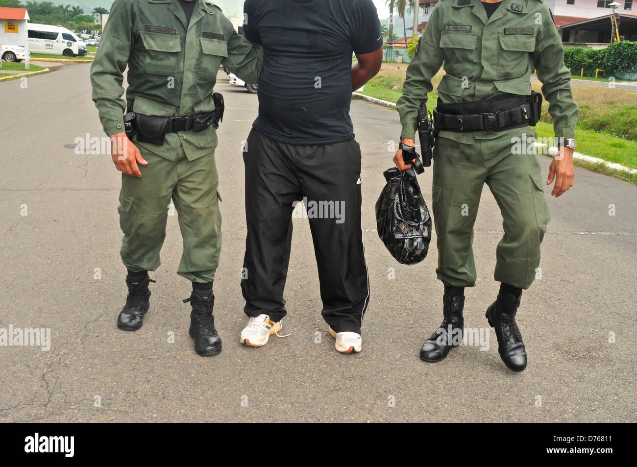 Uniformed police officers arrested criminal tactical