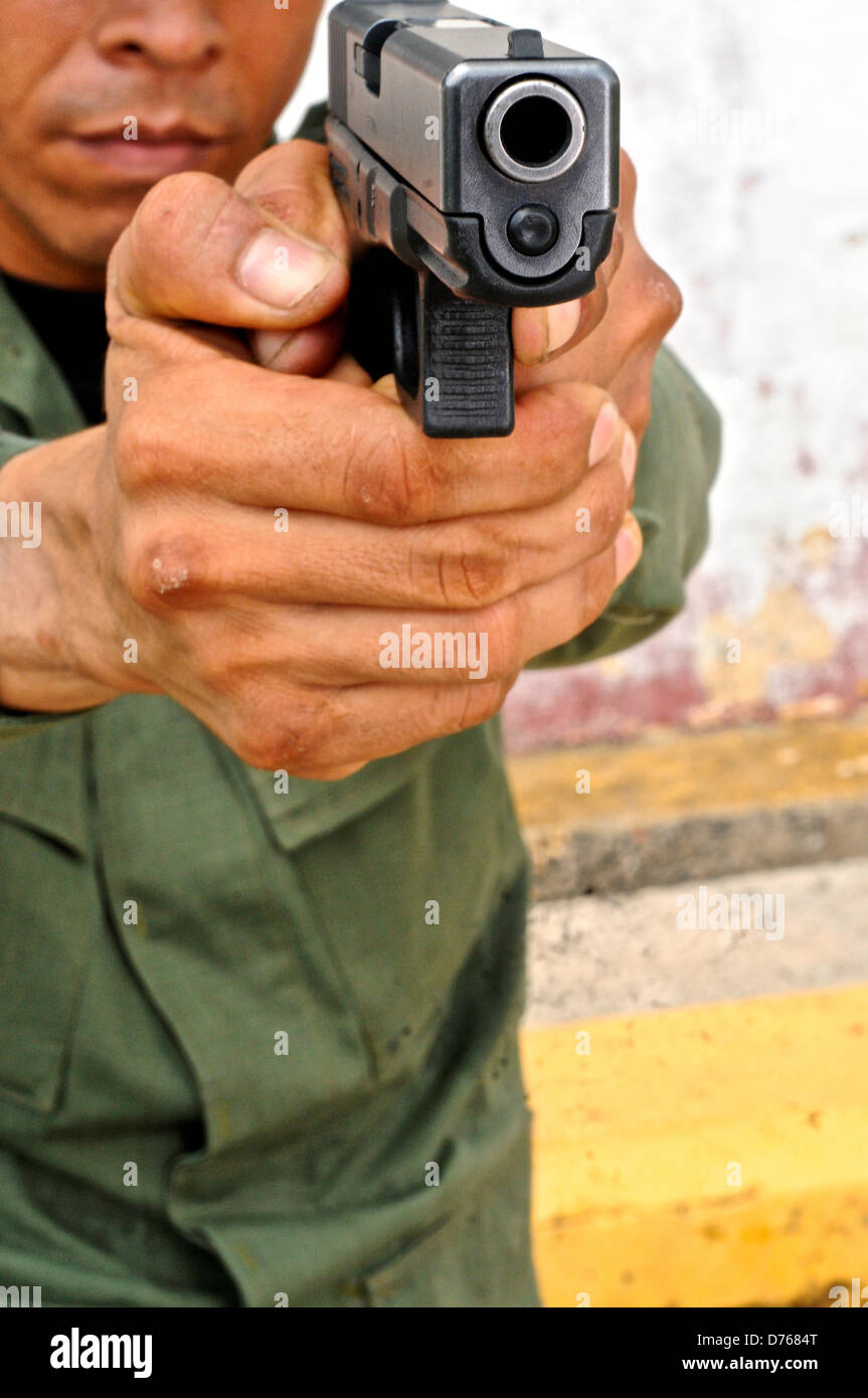 Uniformed police officer aiming pistol tactical firearms training