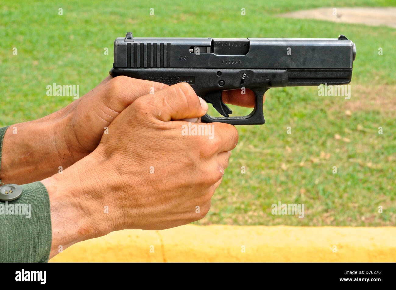 Uniformed police officer aiming pistol tactical firearms