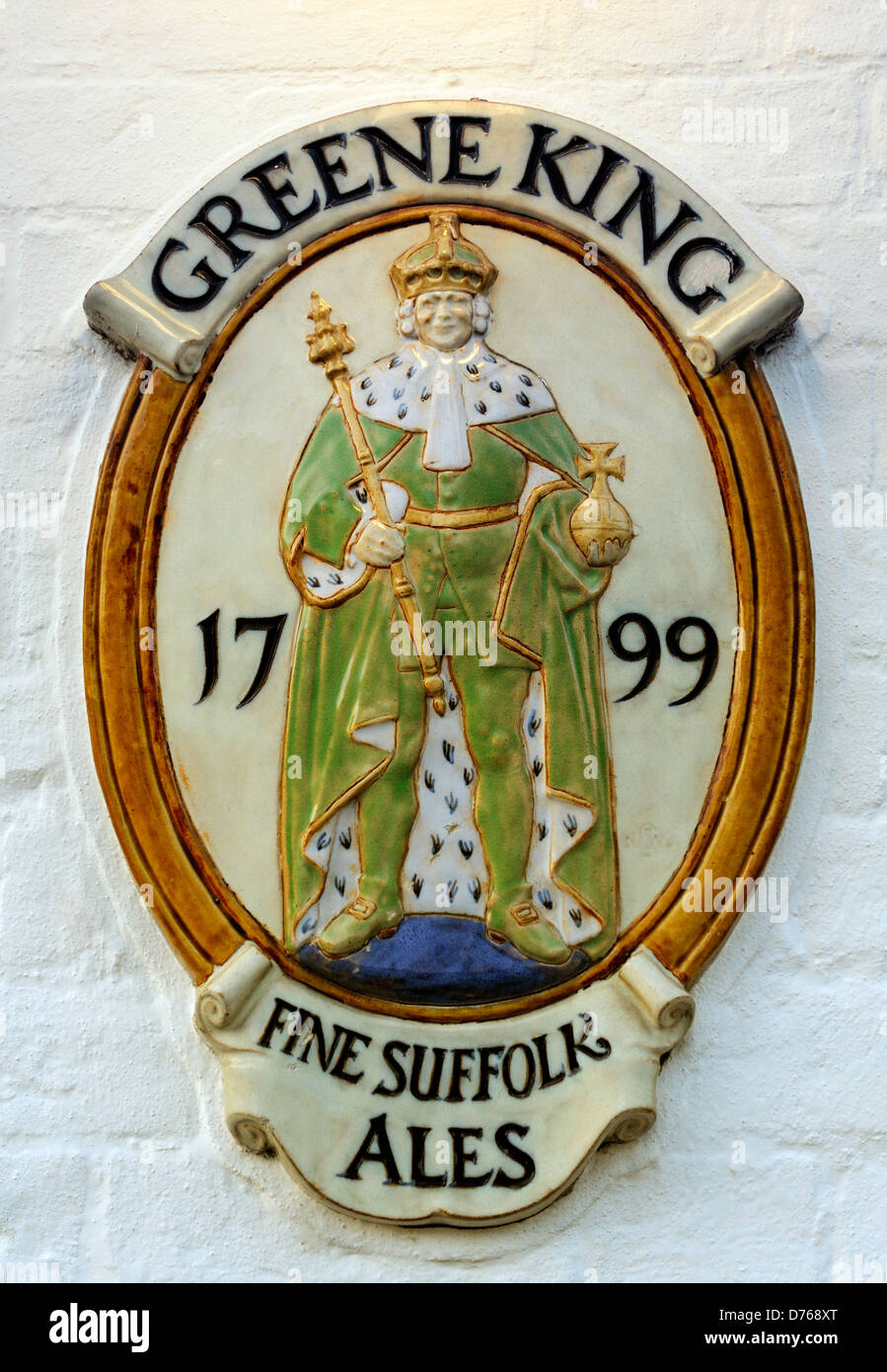 Trade mark pub wall plaque of the Bury St Edmunds based brewery Greene King. A major English beer producer - Stock Image