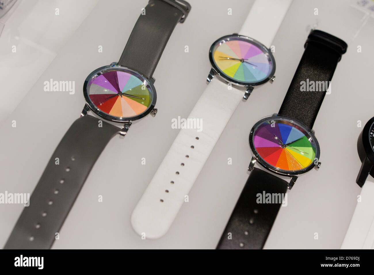 Rainbow face watches - Stock Image