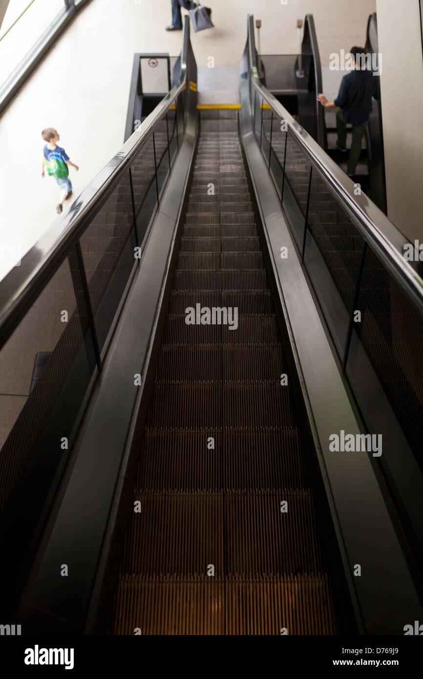 Down escalator - Stock Image