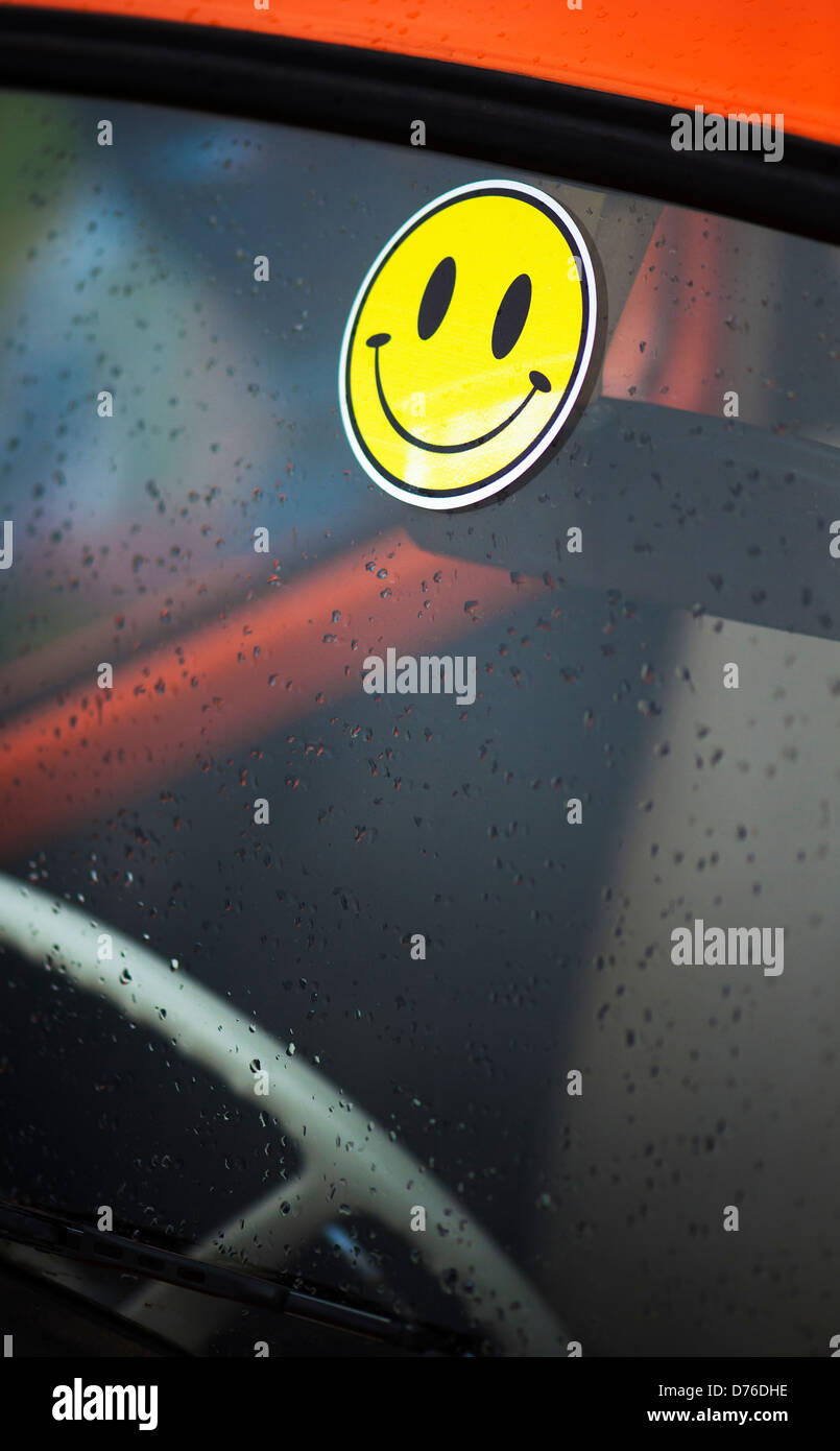 Smiley face sticker on a Volkswagen Beetle windscreen - Stock Image