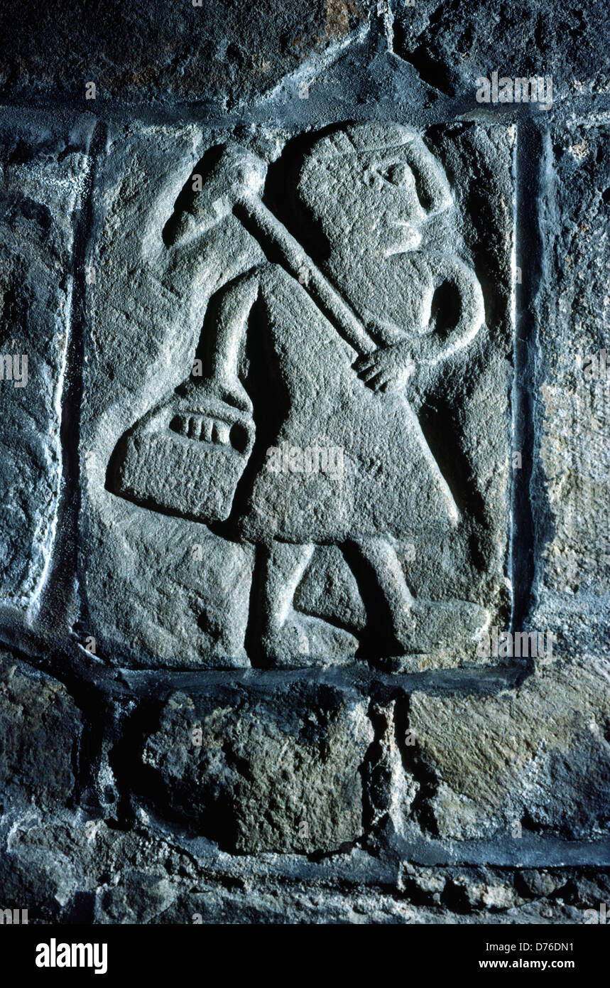 Medieval stone carving of local coal miner inside St. Mary's Church, Wirksworth, Derbyshire, England - Stock Image