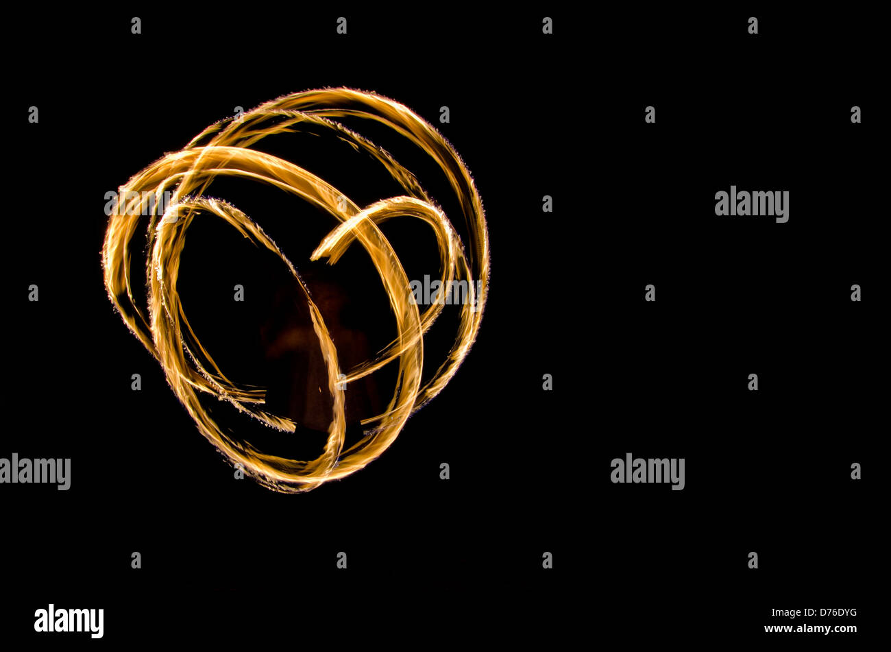 glowing spark spirals - Stock Image