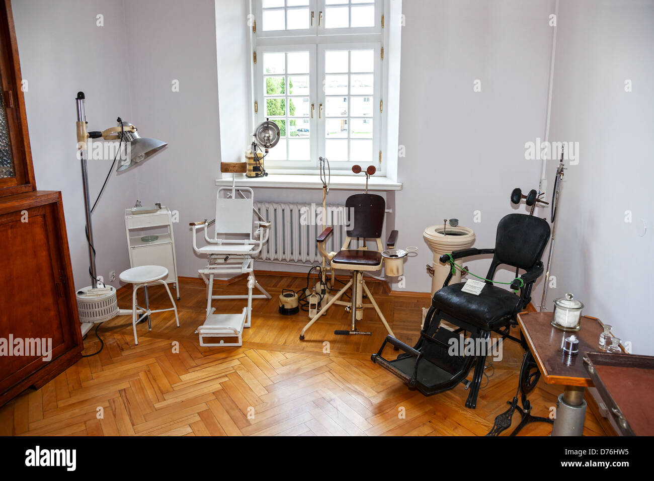 Vintage dentist chair and equipment of the last century. - Stock Image - Ancient Antique Dental Chair Stock Photos & Ancient Antique Dental
