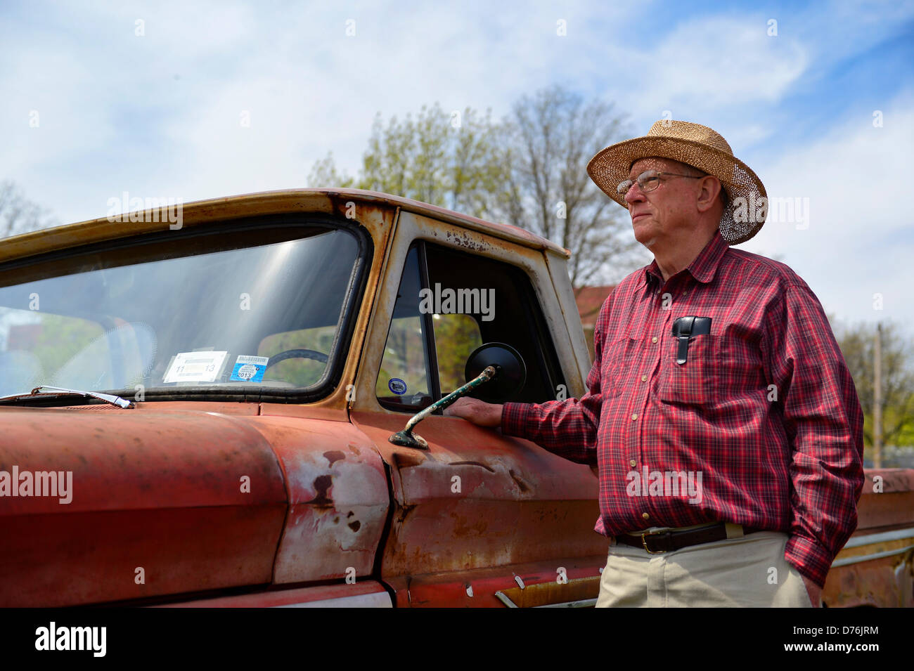 Floral Park, New York, U.S. April 28, 2013. PAUL GRAMLICH is standing next his red and white 1964 Chevrolet C-10 Stock Photo