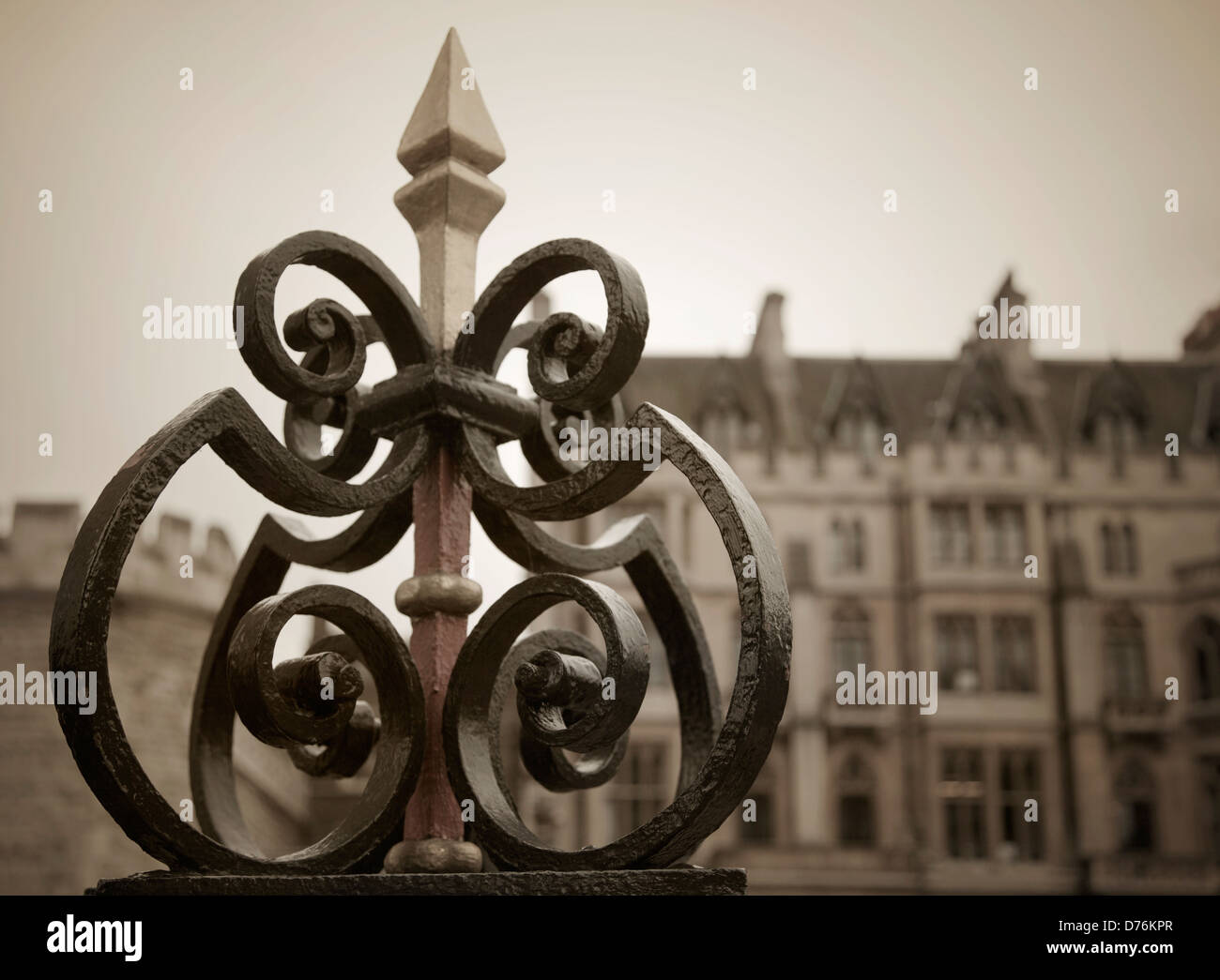 A detail of an ornamental cast iron fence with Dean's Yard in the background, London, UK. - Stock Image