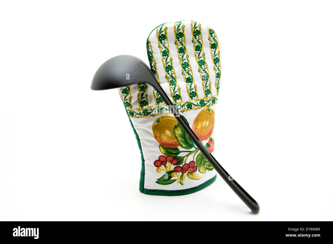 Pot glove and pot holder and soup ladle - Stock Image